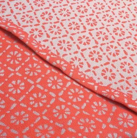 Tekhni Key Largo Chloris Woven Wrap at Purple Elm Baby  Inspired by the vibrant corals of southern Florida's reefs, our exclusive Tekhni Key Largo Chloris wraps are dazzling! Comfortable year round, and perfect with a pair of shades...  Chloris was the ancient Greek goddess of flowers and new growth, so it's fitting that our latest exclusive comes from a wonderful new partnership with Tekhni woven sling studio.   Medium weight wrap in traditional satin weave, similar to Meandros Petra…