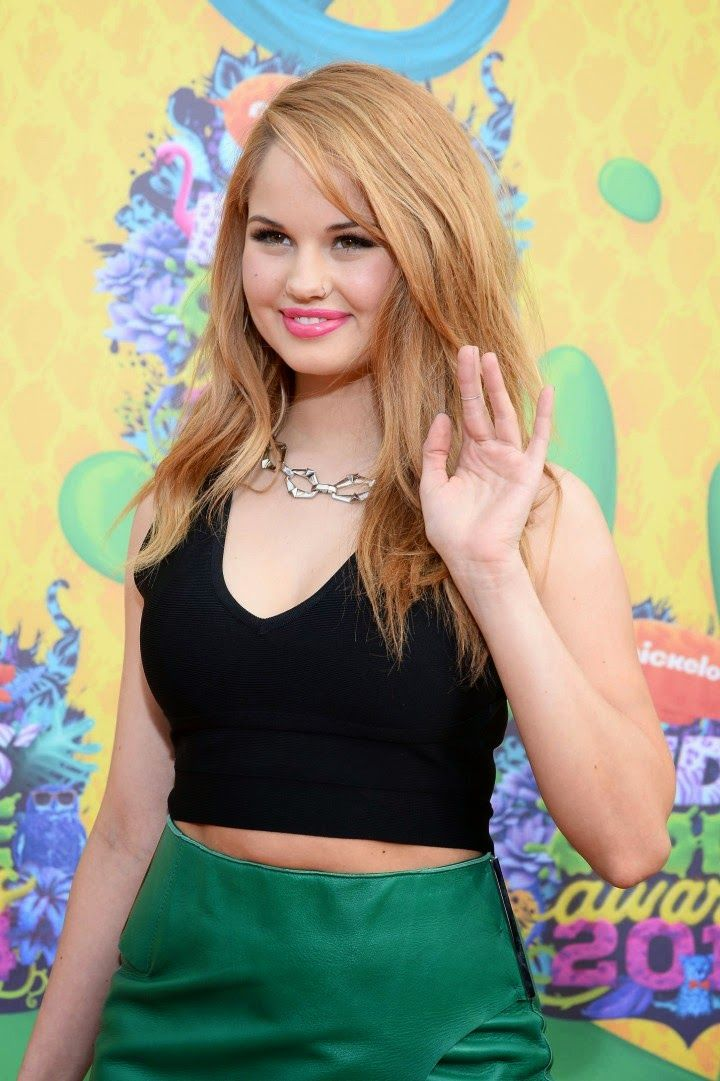 Debby Ryan in a cropped top and wrap skirt at the 2014 Nickelodeon Kids' Choice Awards