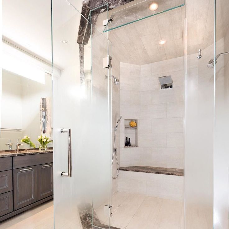 Heated bench...waterfall shower head...all in the comfort of your home  Yes please!  #EvaliaDesign { Third Shift Photography} by evaliadesign
