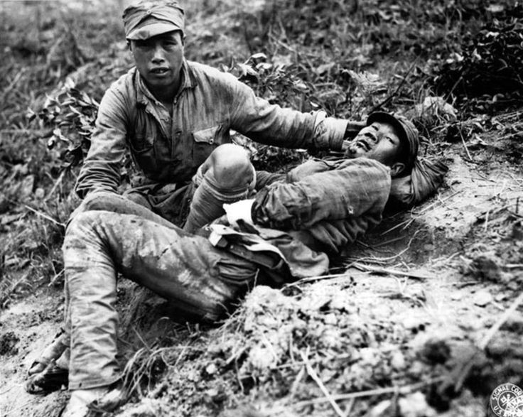 A Chinese soldier tends to a wounded comrade waiting to be transported to a medical dressing station behind the front lines during the Burma Campaign. Combined Allied forces, with soldiers from: China, British Burma (Myanmar), India, U.K., U.S.A., Gold Coast (Ghana), Gambia, Kenya, Nigeria, Northern Rhodesia (Zambia), Nyasaland (Malawi), Southern Rhodesia (Zimbabwe), Uganda, Belgian Congo (Democratic Republic of the Congo), Nepal and Canada would eventually drive the Japanese and Thai…