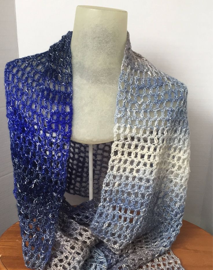 """The sparkles and open pattern of this crocheted evening shawl will add an elegance to your ensemble.   This gorgeous lace stole can be used as a bridal shawl or gifted to your ladies to wear as a bridesmaid shawl.   These crochet wraps measure approximately 14"""" across by approximately 6' long.   I love making custom orders, so if you would like something different than what's listed, contact me and we can create something Fetching!"""
