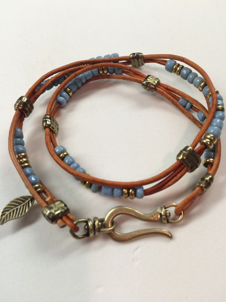 """A double wrap bracelet with blue padres beads. Very frustrating because the strand of padres beads' holes are so irregular a lot of them wouldn't take a 1 mm leather cord. Grrrr...but love the way it turned out! Going to put in my Etsy shop, JeanBeanGifts. Pattern is from Beadshop.com--""""Tahoe"""""""