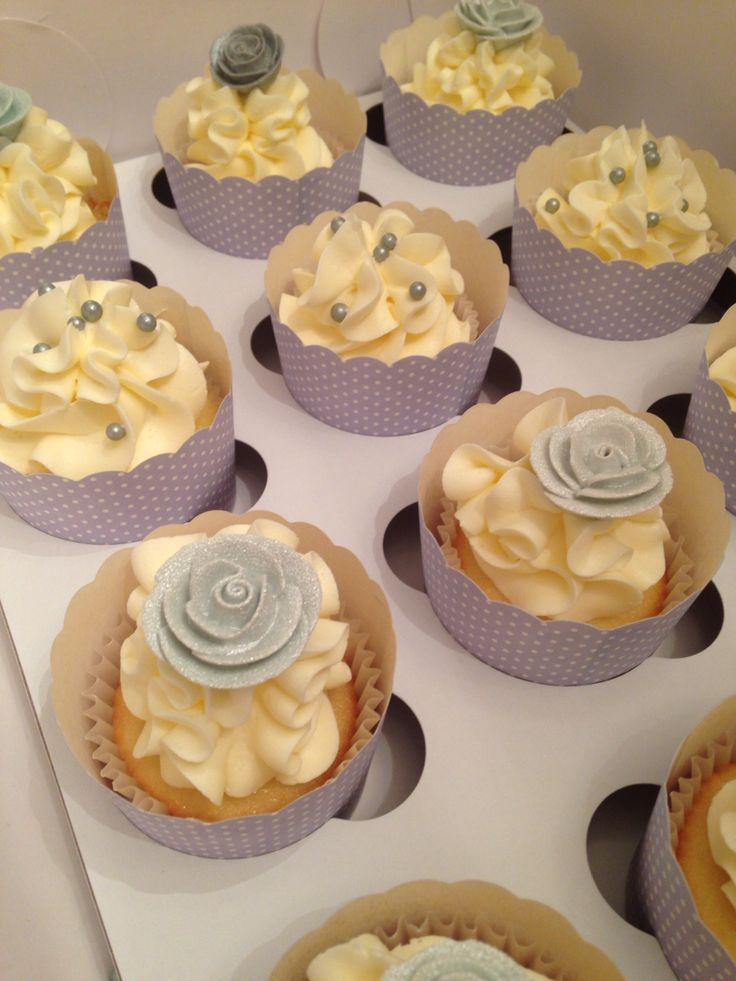Vanilla cupcakes for 25 th anniversary celebration  Silver pearls , silver flowers