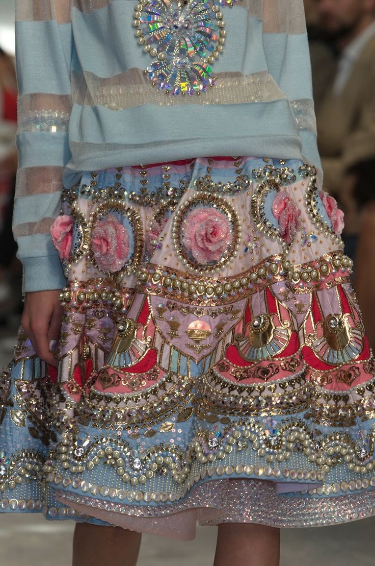 Designer@im_manisharorastuns the crowd with this 3d embellished skirt, brimming with pearls, sequins and flowers. #PFW #SS15