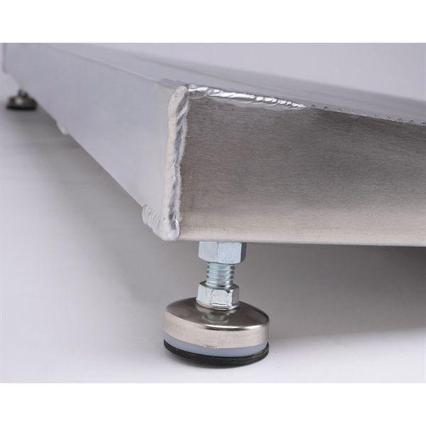 Casters under doorway ramp designed to adjust