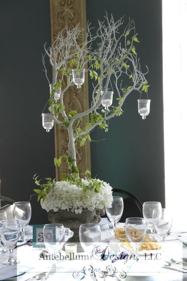 Tall white manzanita branches with hydrangea smilax