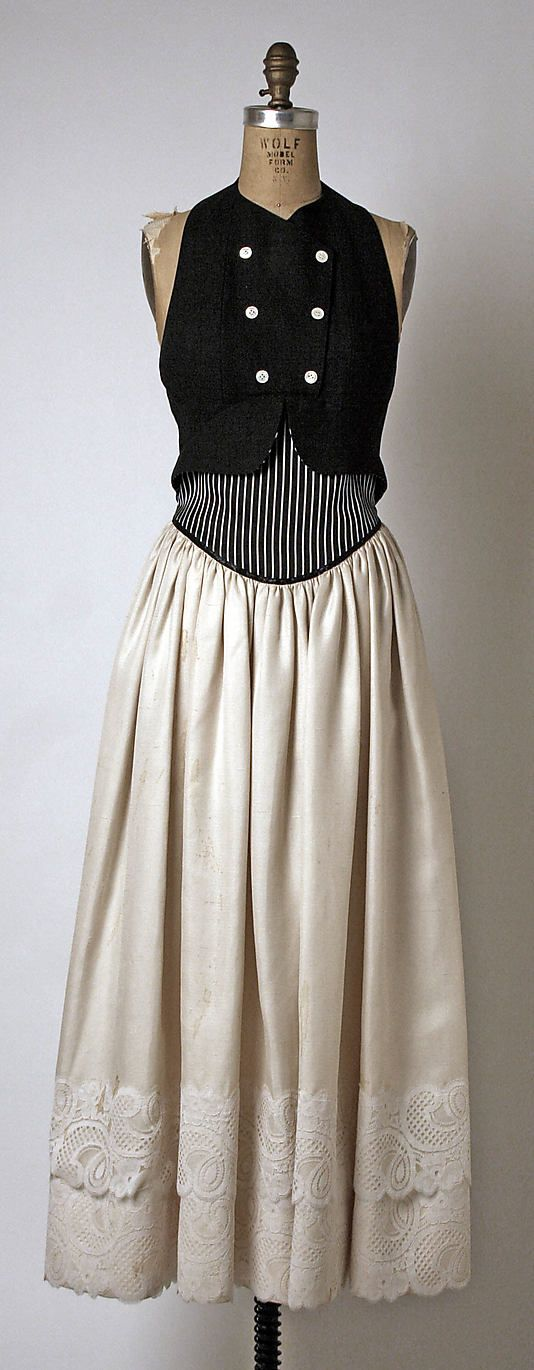 Cotton, satin, and silk backless dress with faux vest top and whitework-edged tiered skirt, by Geoffrey Beene, American, spring/summer 1987.