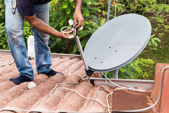 Worker Installing Satellite Dish And Antenna On Roof Top With Images Satellite Dish Television Antenna Installation