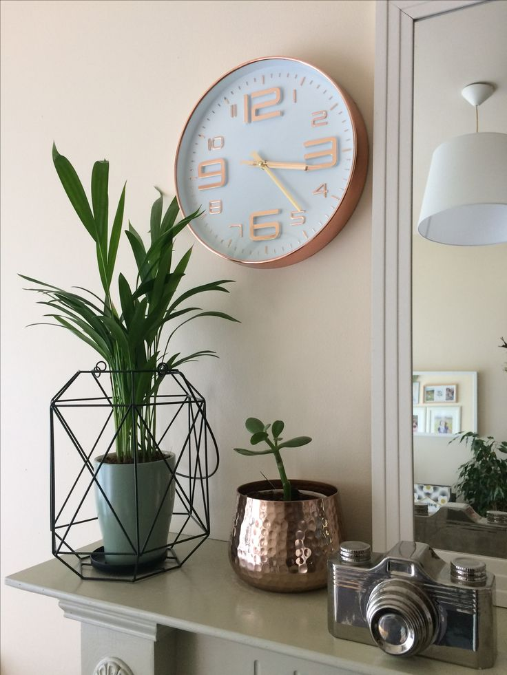 Clock from Penneys, Black lantern frim Sostrene and Grene, Copper plant pot from B&Q, Silver Camera from Mr Price! Mirror from Dunnes Stores. Green pot is my old sugar jar!