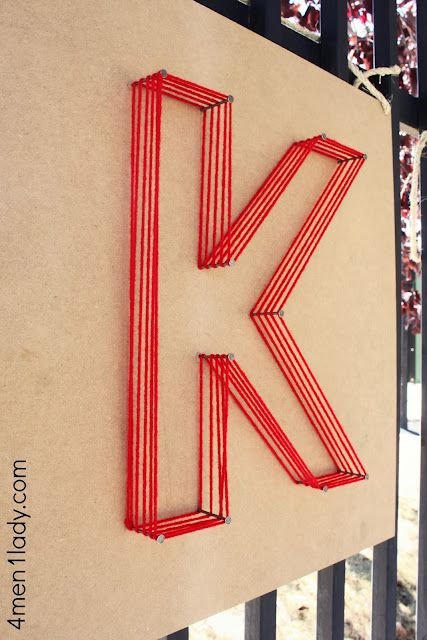 Large letter art ... nails and yarn. This could be done outside with plastic