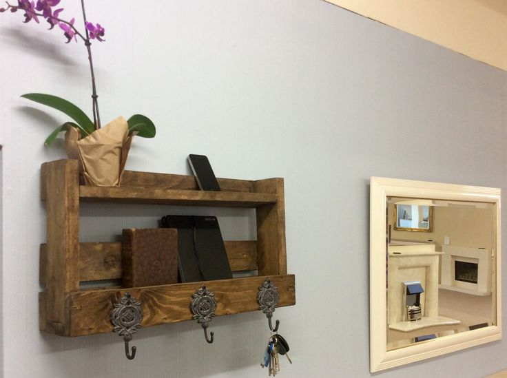New palletwood project completed. A coat rack for the shop. Authentic stained palletwood from a stove delivery and hooks from Lemvig, Denmark.