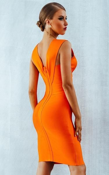 8f03f43ef35 What's not to love in this curvy and colorful piece. It's hot, sexy and  bright orange. If you have a fiery soul, then this dress is you.