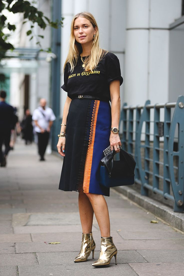 40+ Street Style Looks That Slayed London Fashion Week #refinery29 http://www.refinery29.com/2016/09/123831/lfw-spring-2017-best-street-style-outfits#slide-6 It looks like gold boots might be the footwear choice of the season.Christopher Kane shirt, J.W. Anderson bag....