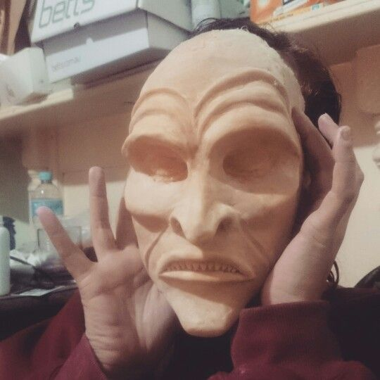 A latex witch mask.  We took casts of our faces, sculpted the mask over the top, cast that and then used latex to create the mask