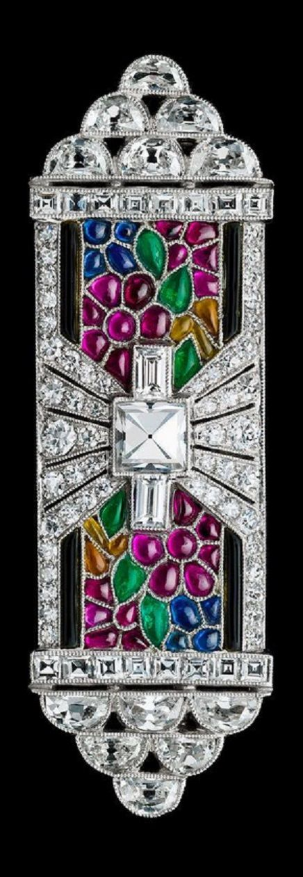 An Art Deco platinum, diamond and gem-set Giardinetto brooch, circa 1930. Set with diamonds, emeralds, rubies and sapphires.