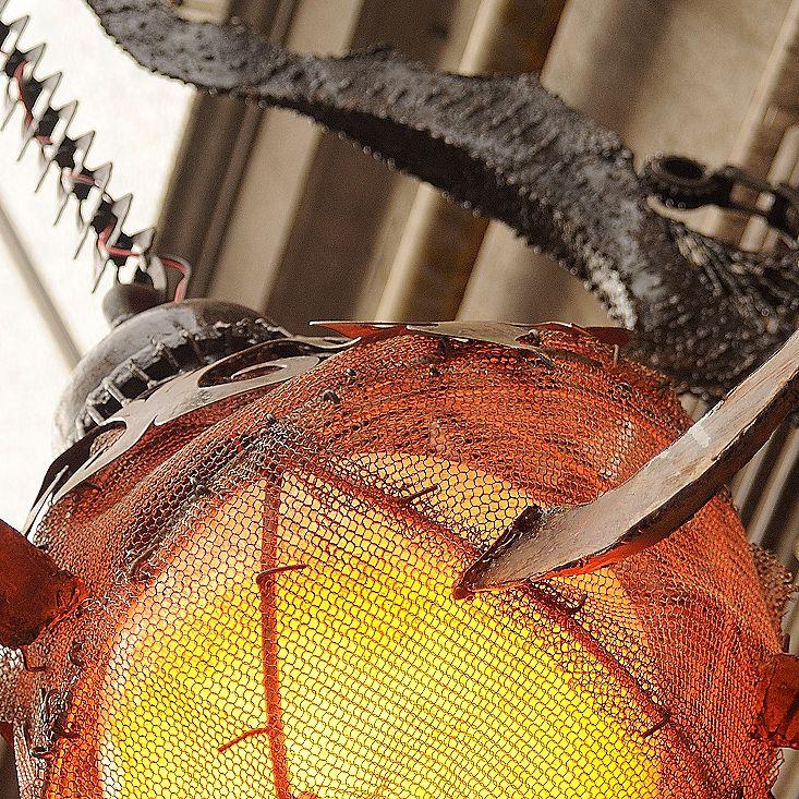 Metal lamp welded from scrap. Surindustrialle Gallery in Lodz / Poland. Scrap metal art, welding applied art and jewellery