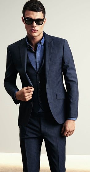 House of Fraser - Indigo 'Hendrickson' suit jacket £230/€275, waistcoat £55/€72, dark navy shirt £79/€103 and trousers £120/€156 All Kenneth Cole at House of Fraser Wayfarer sunglasses £170 Ray Ban