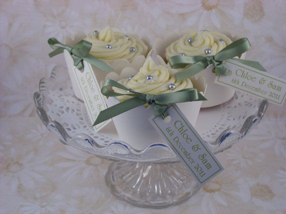 100 personalised cupcake wrappers with ribbon and tags on Etsy, $74.45