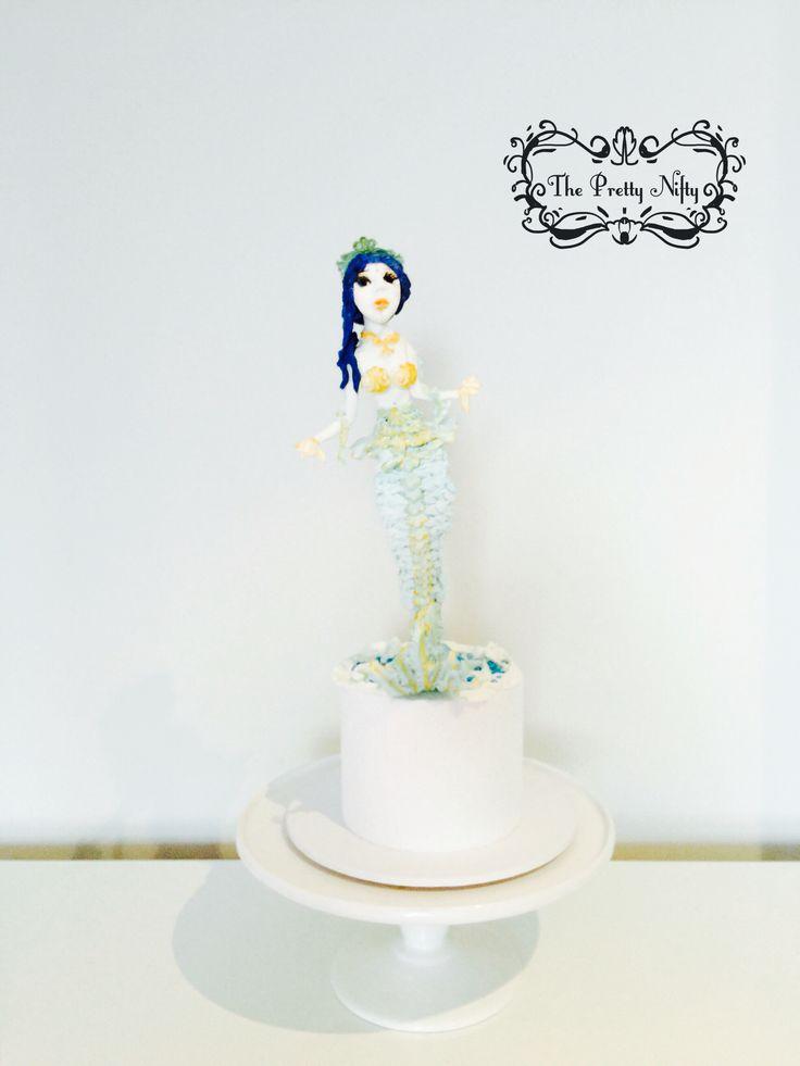 Oceana Sirena is an ocean mermaid. Made with fondant icing.