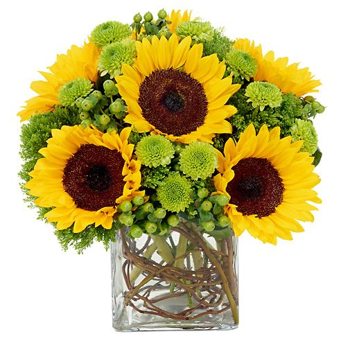 Sunflower arrangement - love the branches in the vase or could use preserved fall leaves or marbles