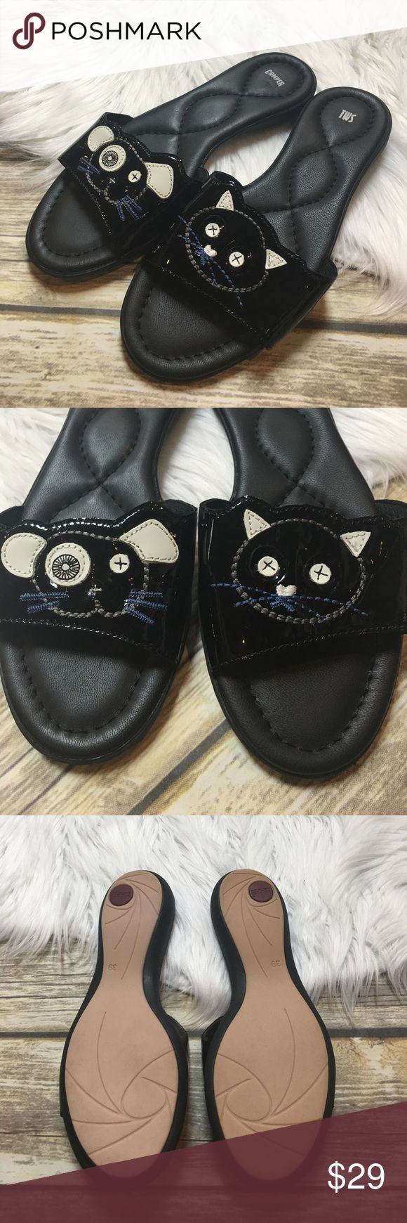 Camper Twins Collection Dog & Cat Slide Sandals Camper slip on sandals. Part of the twins collection with a dog and cat. Cushioned leather sole. In great preowned condition. Size 39 is equivalent to US size 9. Fit snug, could almost pass as a 8 1/2. Camper Shoes Sandals