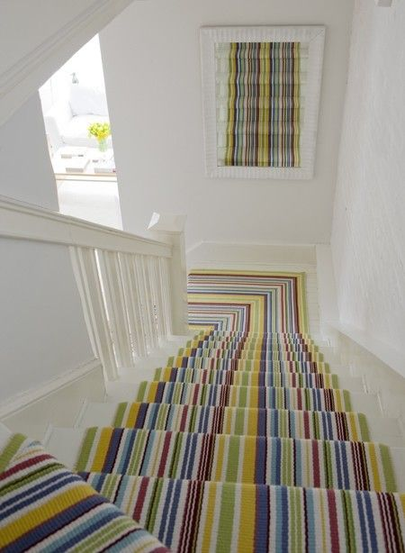 Stripey Stair runner - elongating.  White stairs and skirting boards
