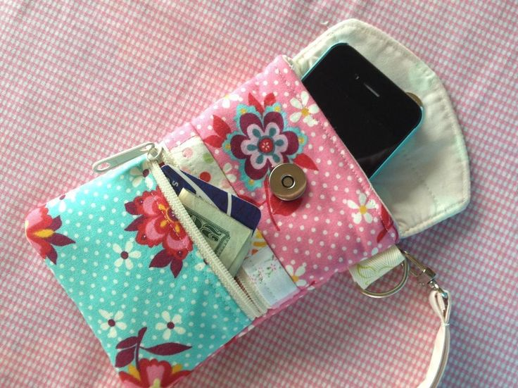 A cute cellphone wristlet from Trillium Design.  Includes a small change purse pocket as well as a nice wrist strap.  You could easily add a zippered pocket on the back for an ipod, headphones, or a charger cord.