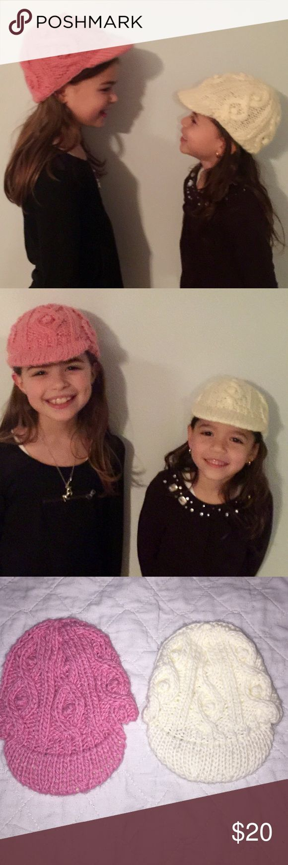2 Newsboy Cable Knit Hats Fits size 2-6 years EUC 2 Adorable Newsboy Cable knit Hats from San Diego Hat Company. 1 pink & 1 ivory. Size says 0-12 months but as you can see my daughters are modeling them. Best fit 2-6 years (has stretch to them) only worn 1x and for modeling. Excellent Condition San Diego Hat Company Accessories Hats