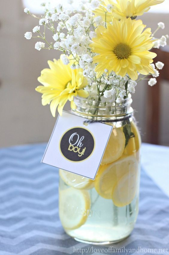Gray & Yellow Baby Shower Decorating Ideas. Easy centerpieces with lemon slices, baby's breath, & yellow mum daisies. Beautiful for any Spring party!