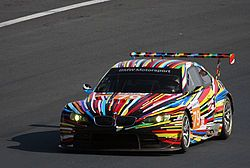 The Jeff Koons-designed BMW Art Car on a race track