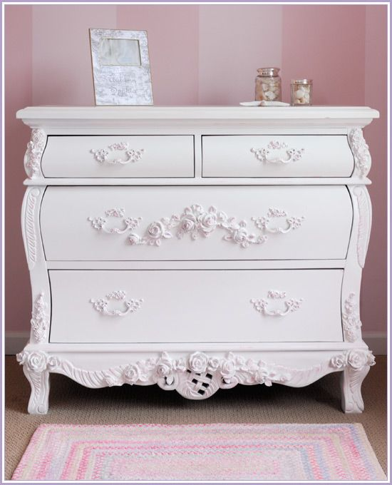 Victorian Style Dresser: It has the floral carvings just like bed frame does and has a curvy structure. I would however paint it a bright pink like the end table.
