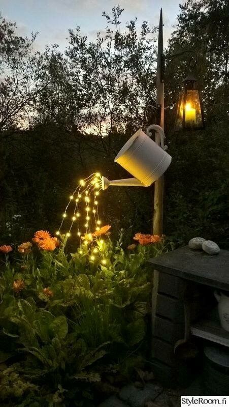 IKEA metal watering can with string lights