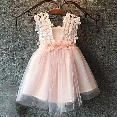 Perfect dress for a little girl for a family with a peachy pallette  Daisy Dress - Little Trendsetter
