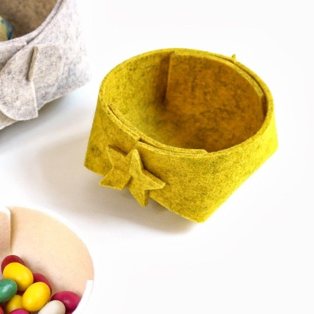 This is a foldable basket in yellow felt by Skandinavious by Louise Vilmar. #nordicdesigncollective #yellow #trend #trendcolor #trendcolour #easteryellow #easter #basket #yellowmelange #felt #star #stars #contain #container #foldable #flat #wool #swedishdesign #nordicdesign #scandinaviandesign #skandinaviousbylouisevilmar #louisevilmar