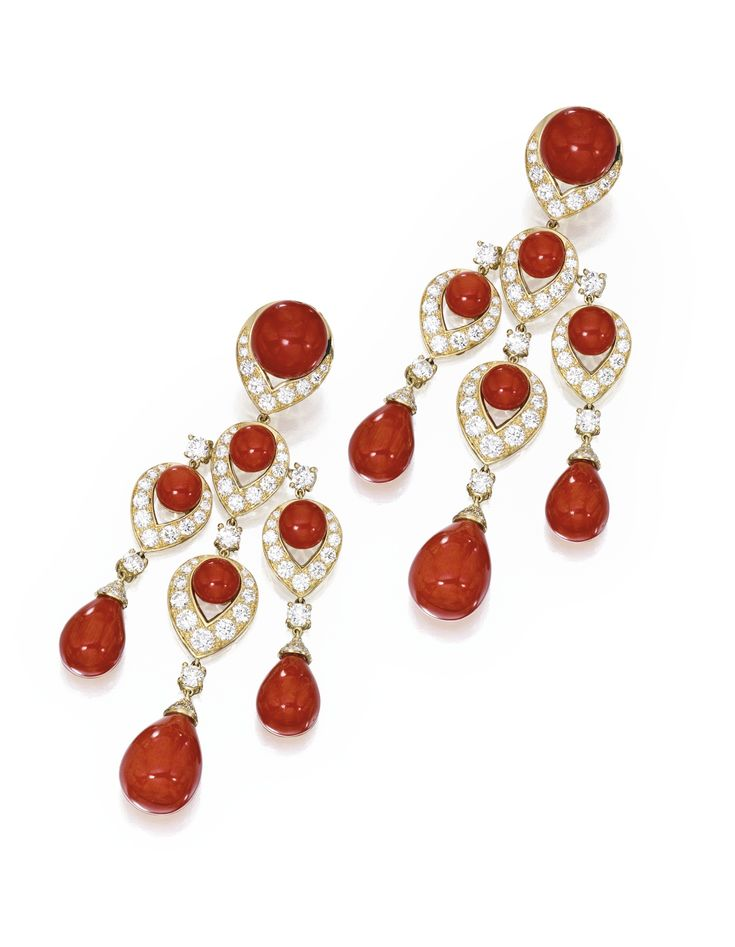 PAIR OF 18 KARAT GOLD, CORAL AND DIAMOND PENDANT-EARCLIPS, BULGARI. The articulated fringes set with ten button-shaped coral cabochons, suspending six coral drops, set with round diamonds weighing approximately 5.75 carats, signed Bulgari.