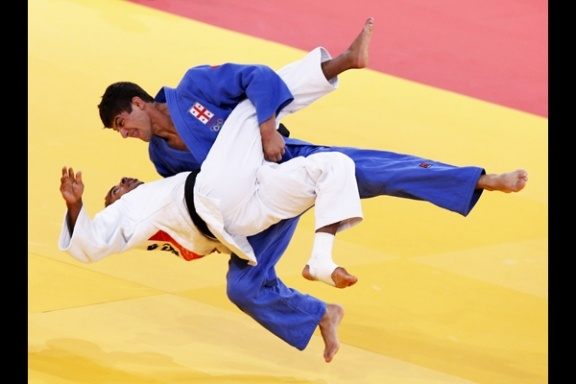 Men's Judo  France's David Larose fights with Georgia's Lasha Shavdatuashvili (blue) in their men's -66kg elimination round of 16 judo match at the London 2012 Olympic Games July 29, 2012.