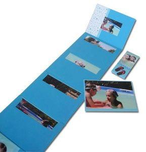 Mini Envelope Scrapbook  Just stick the back of one envelope to the back of the next one....