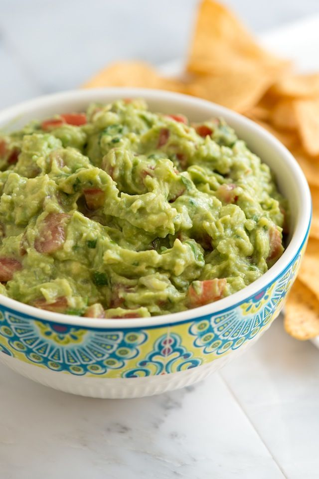 Our Favorite Guacamole Ingredients 1/4 cup finely minced onion 3 ripe Haas avocados 1 1/2 tablespoons fresh lime juice (or lemon juice) 1 large Plum or Roma tomato, deseeded and diced (1/2 cup) 1 tablespoon chopped cilantro leaves, optional 1/2 teaspoon ground cumin 1/2 teaspoon salt 1 to 2 teaspoons minced jalapeño or Serrano pepper, optional