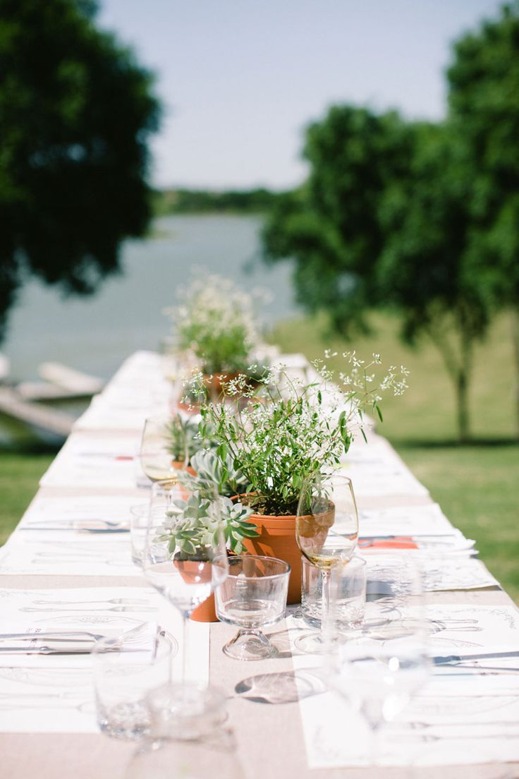 Rustic table setting with potted plant centerpieces.  Photo by Jess Barfield Photography.  www.wedsociety.com  #wedding #tablescape