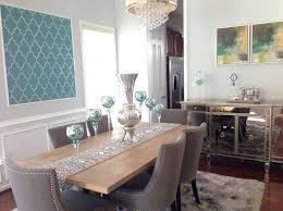 """Upholstered chairs sure add a little """"bling"""" to a dining room table."""