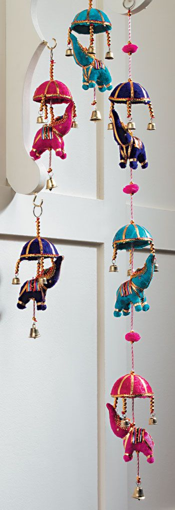 String of 3 Indian elephants with umbrellas