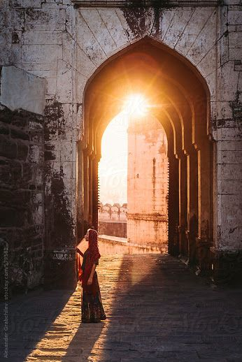 Woman stands near arch in Mehrangarj Fort, India - loved & pinned by www.omved.com