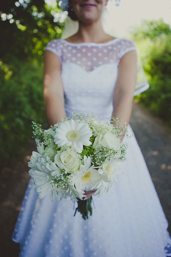 Beautiful white on white wedding bouquet, from 'A 50's Style Candy Anthony Gown For A Green Polka Dot Inspired Barn Wedding' http://www.amybphotography.co.uk/