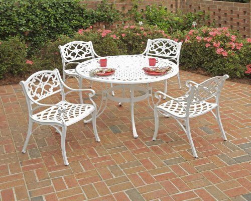 Home Styles 5552-328 Biscayne 5-Piece Outdoor Dining Set with Round Table and Arm Chair, White Finish, 48-Inch by Home Styles. $833.15. Constructed of cast aluminum with a white finish. Features include powder coat finish sealed with a clear coat to protect finish. Table measures 48-inch width by 48-inch depth 30-inch height and chair measures 22-5/6-inch width by 21-2/3-inch depth by 32-2/3-inch height. Biscayne collection outdoor dining set. Set comes with one table and four...