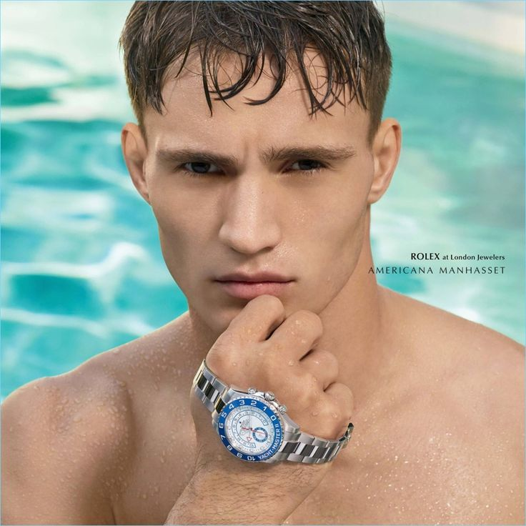 Emerging from the pool, Julian Schneyder sports a Rolex timepiece.