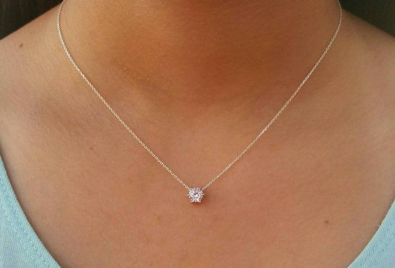 Check out this item in my Etsy shop https://www.etsy.com/listing/254197761/floating-diamond-necklace-single-diamond