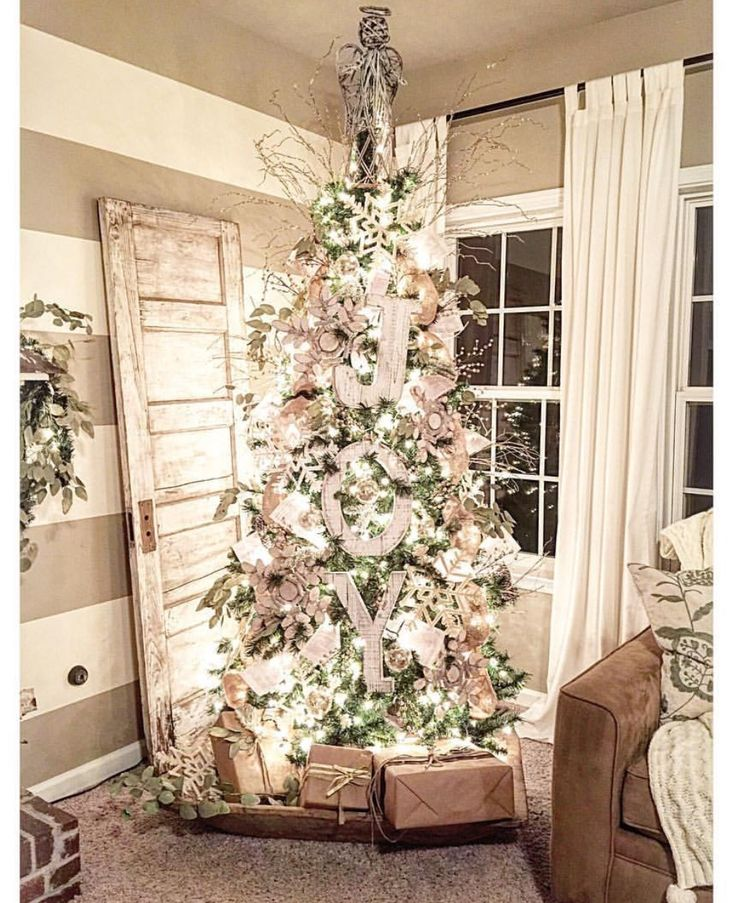 Elegant farmhouse Christmas tree in neutral colors.
