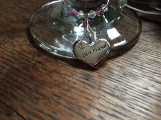 This beautiful Wine Glass Charm makes a lovely gift for one of your best friends - Set with a silver plated heart encrusted with a diamante and engraved with Best Friend - This is a lovely gift on it's own or could be added to a bottle of bubbly or a funky wine Glass <br><br>For customised colours t...