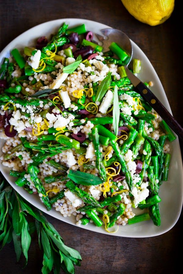 Roasted Asparagus Salad with Israeli cous cous, olives, feta, pine nuts and lemony dressing. Serve warm as a vegetarian side, or chilled as a salad!