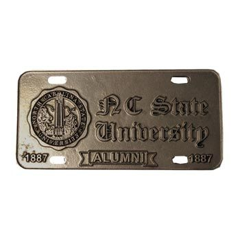Show your Pack Pride when you ride! This heavy duty pewter license plate features NC State University Alumni in Old English Text as well as 1887. The NC State seal is also on the Plate.